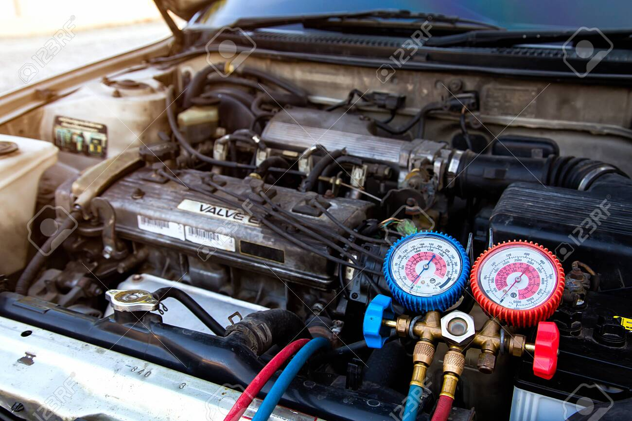 Measuring equipment for filling car air conditioners checking. Concepts of car Repair service and car insurance. - 146457359
