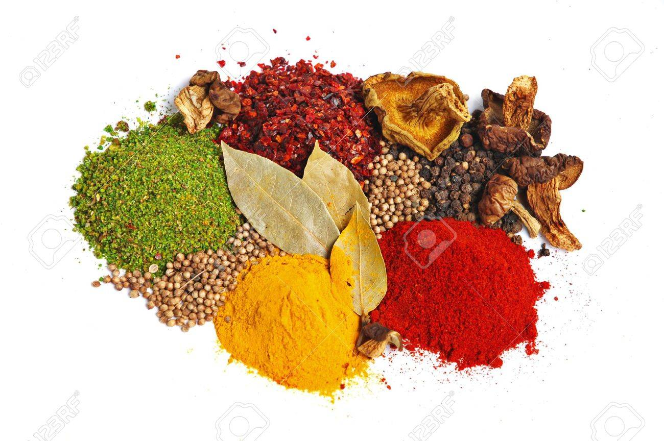 Piles of spices: parsley, red paprika, whole black pepper, white coriander, curcuma, laurel leaves and dry porcini mushrooms. Stock Photo - 2923850