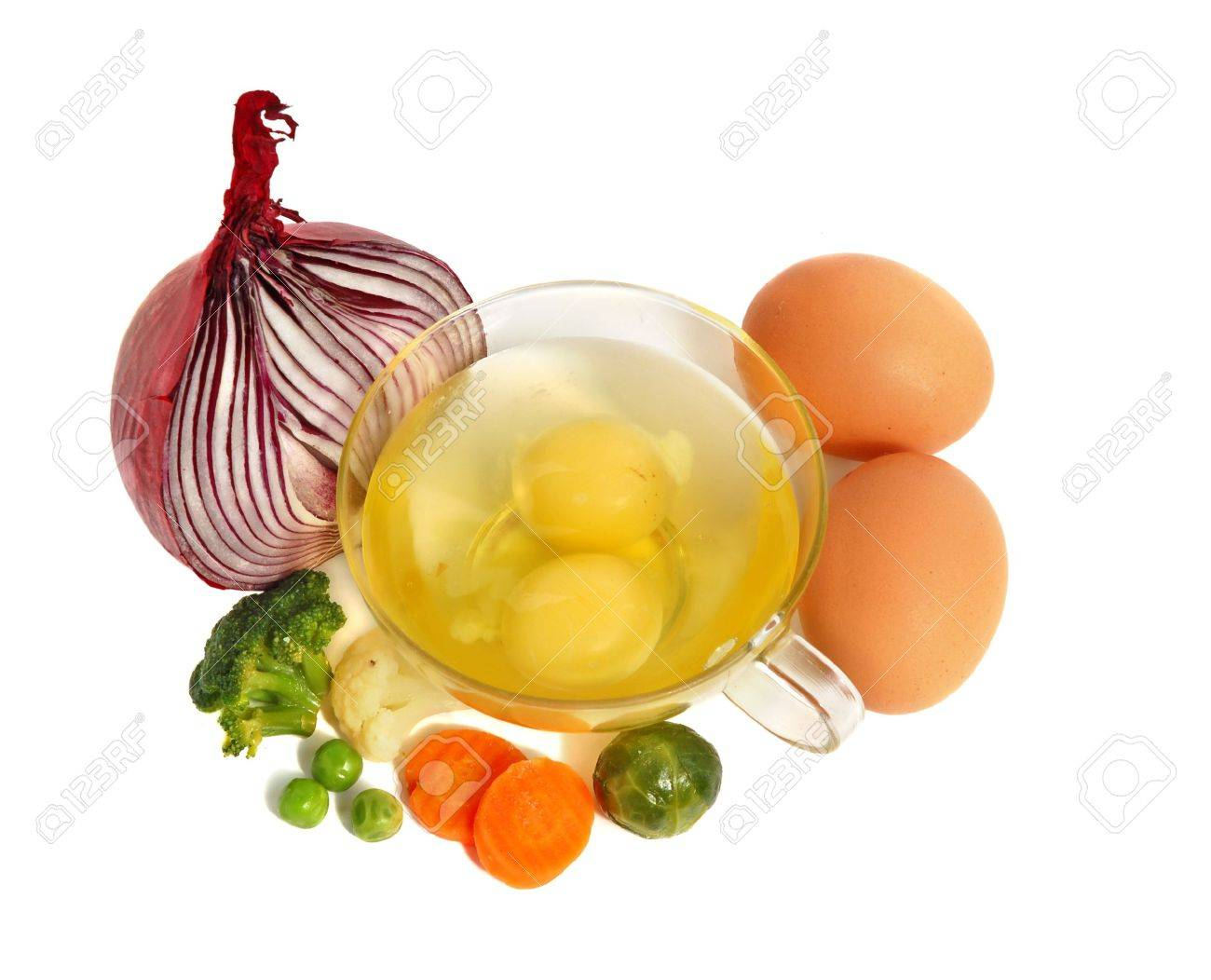 Raw eggs in a glass cup and different vegetables, healthy breakfast. Stock Photo - 2957134