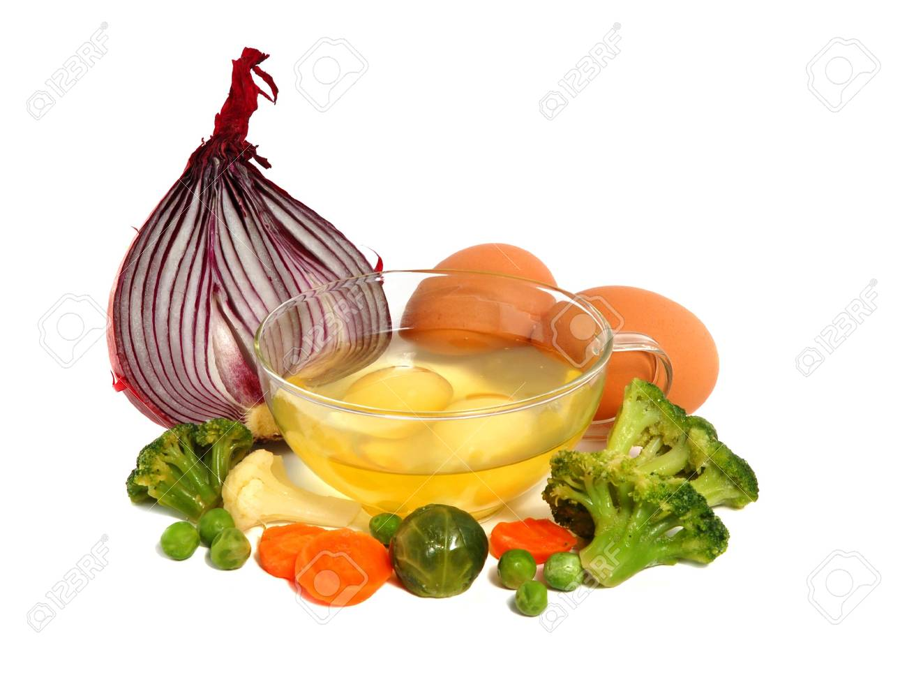 Raw eggs in a glass cup and different vegetables, healthy breakfast. Stock Photo - 3114139