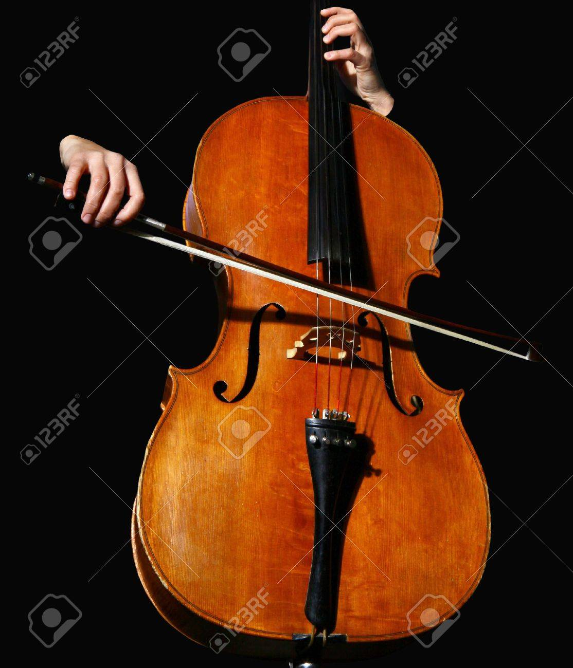 Close up of a cello on black background Stock Photo - 6136179