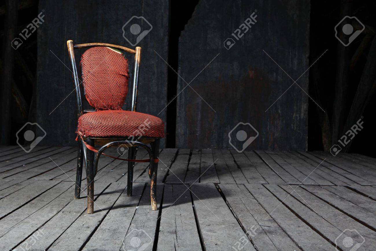 Old fashioned chair on wooden floor Stock Photo - 6110236