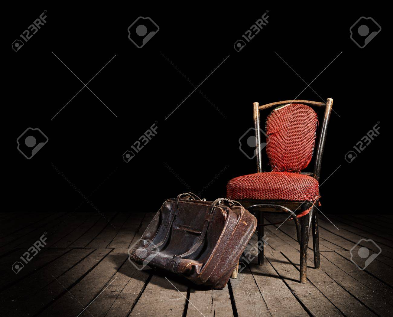 Red chair photography - Old Red Chair And Well Traveled Vintage Suitcase On Wooden Floor Stock Photo 14058573