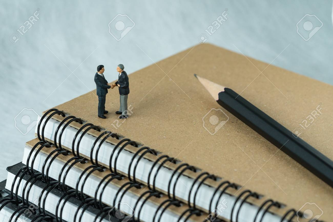 Miniature People Small Figure Businessmen Handshaking And Standing