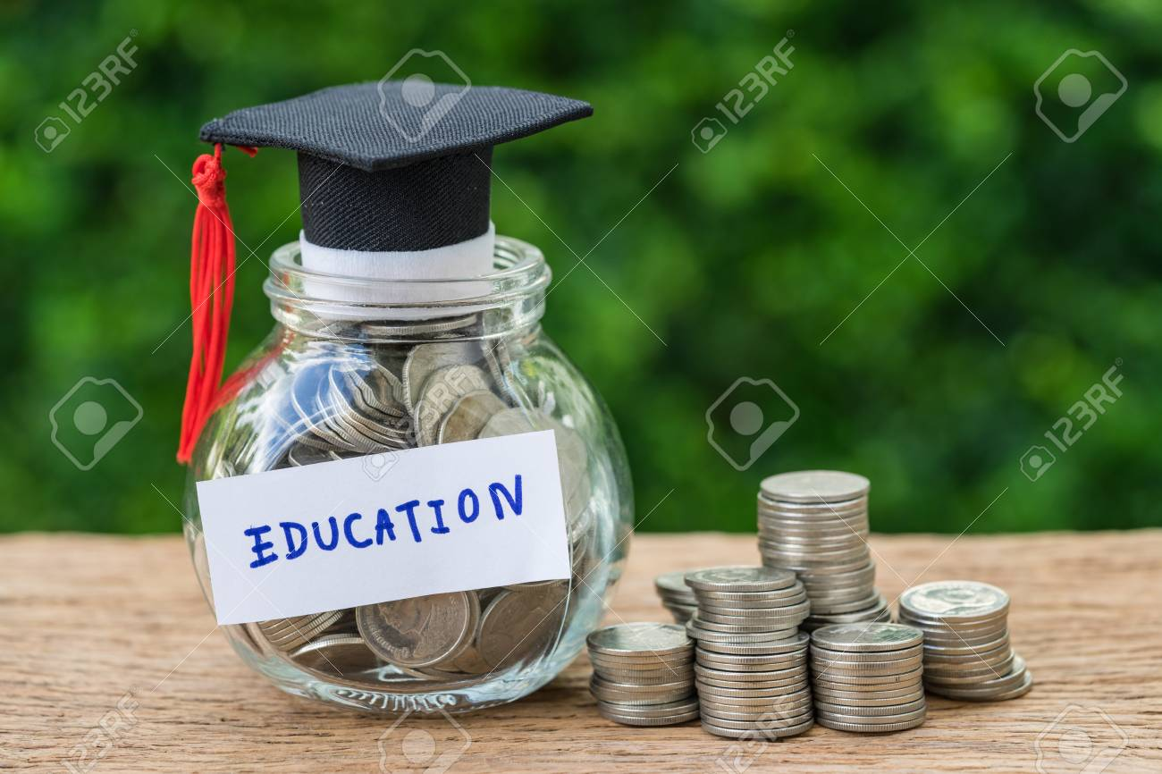 glass jar with full of coins and graduates hat label as Education, education and stack of coins or savings concept. - 88052467