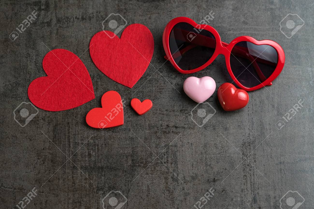 Red And Pink Heart Shapes With Heart Shape Eyeglasses On Black