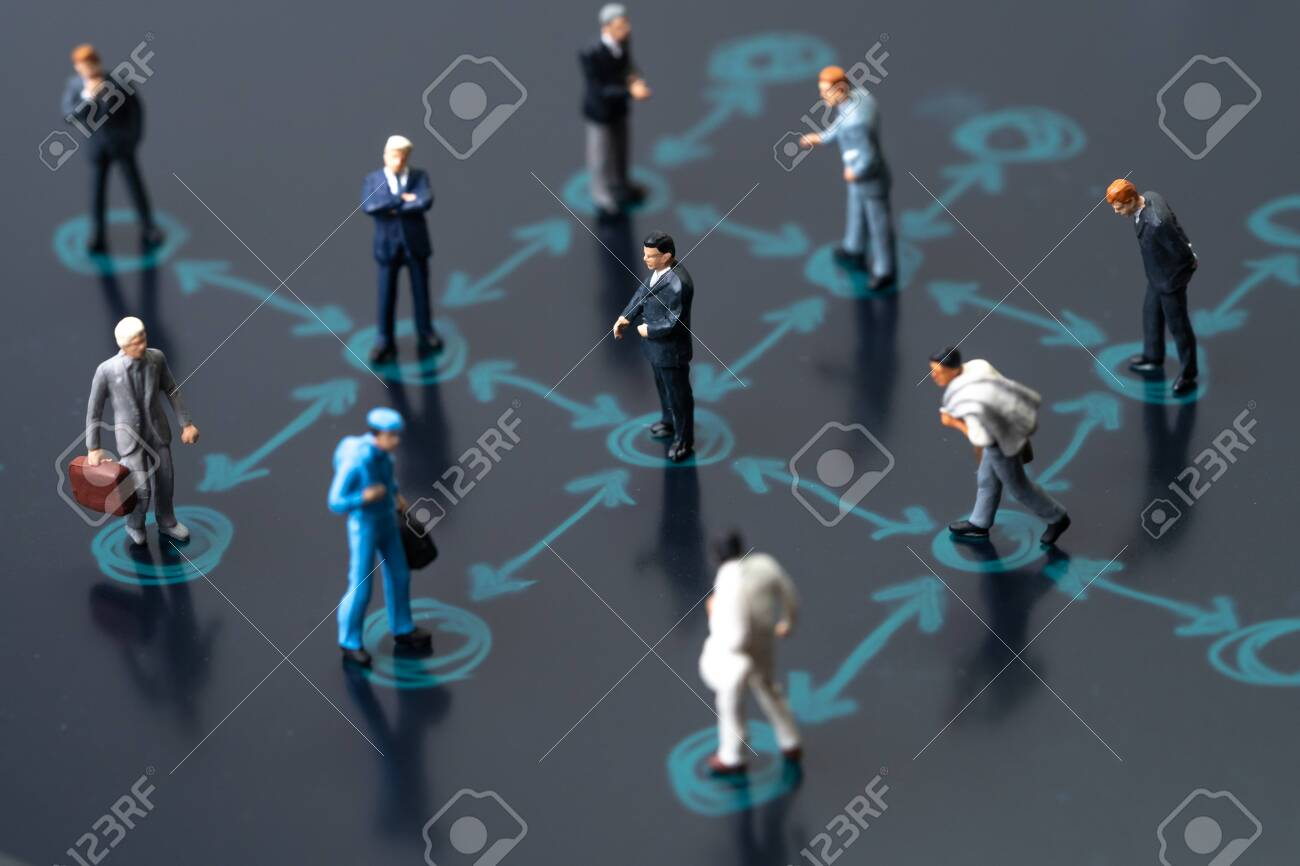 Social distancing, keep distance in public society people to protect COVID-19 coronavirus outbreak spreading concept, businessmen miniature keep distance away in the meeting with distant measure. - 142840807