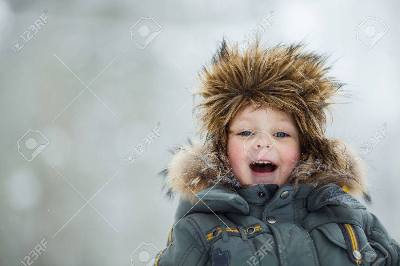 Closeup portrait of happy child in winter hat Stock Photo - 12393047