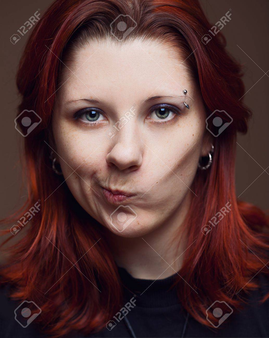 Strange emotion on young woman's face Stock Photo - 12658983