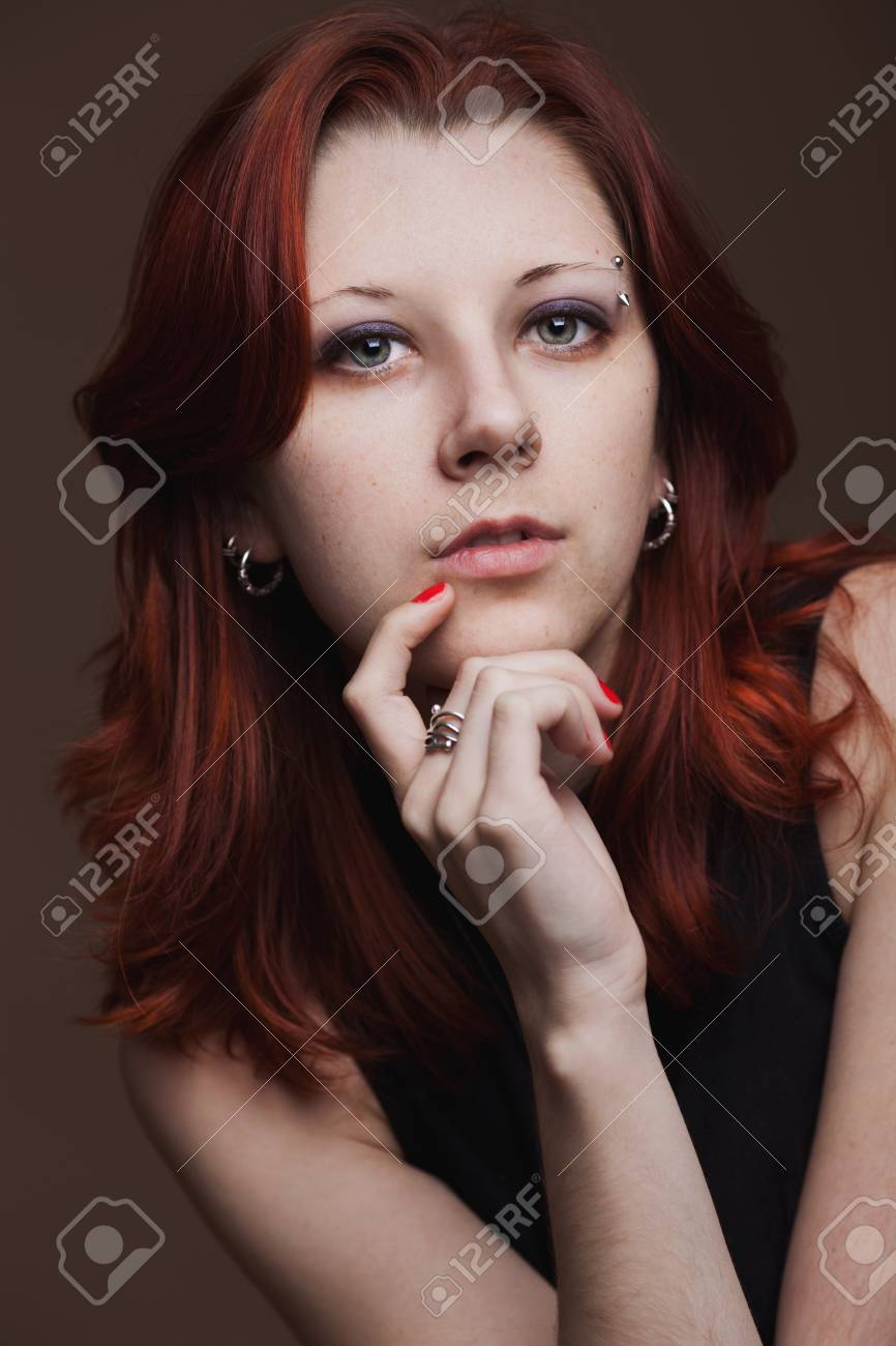 Close-up portrait of young woman on dark background Stock Photo - 12658980