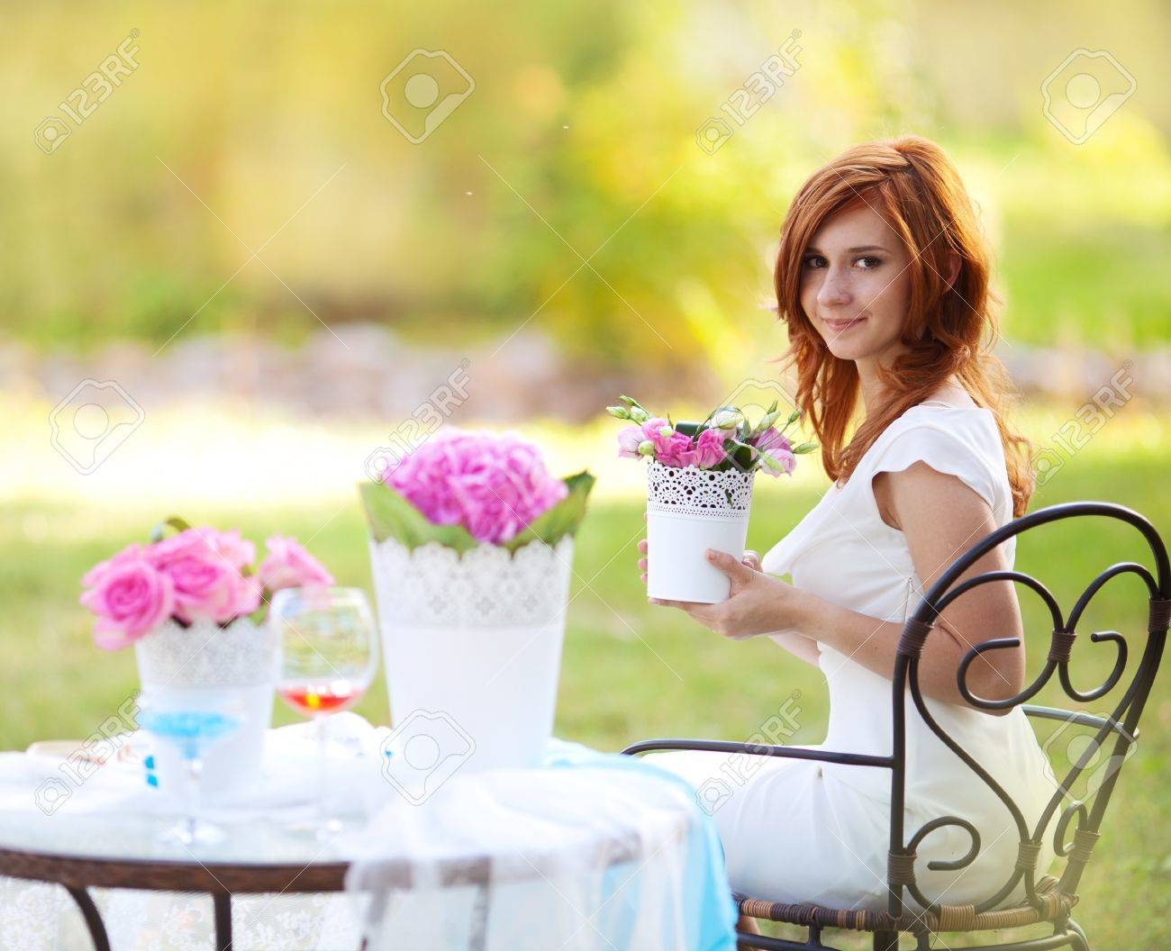 portrait of beautiful young woman with flowerpot in the hands Stock Photo - 13164353