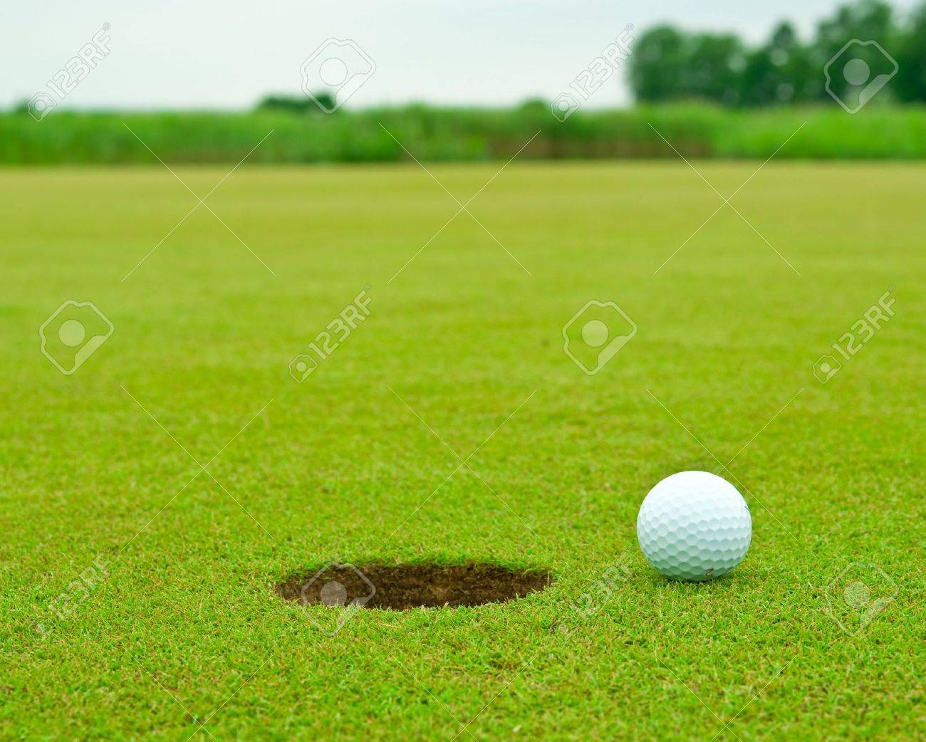 Golf ball very close to the hole Stock Photo - 7292705