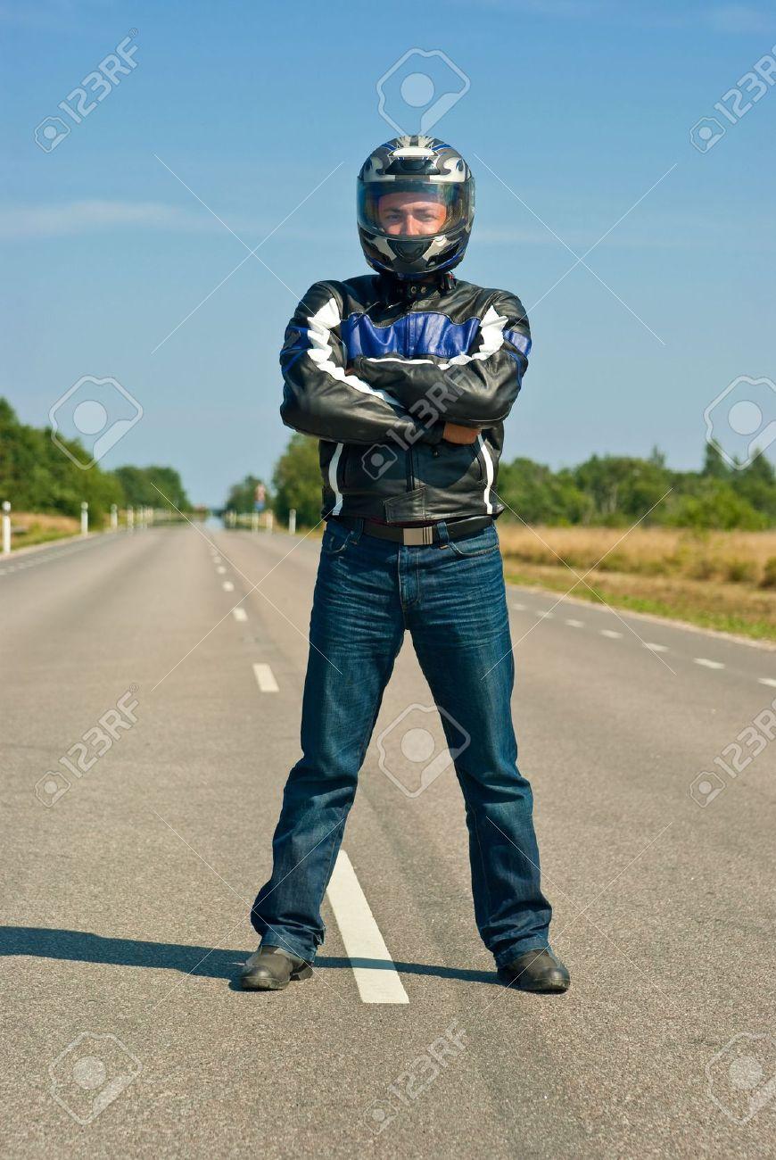 biker standing in the center of empty road Stock Photo - 7508076