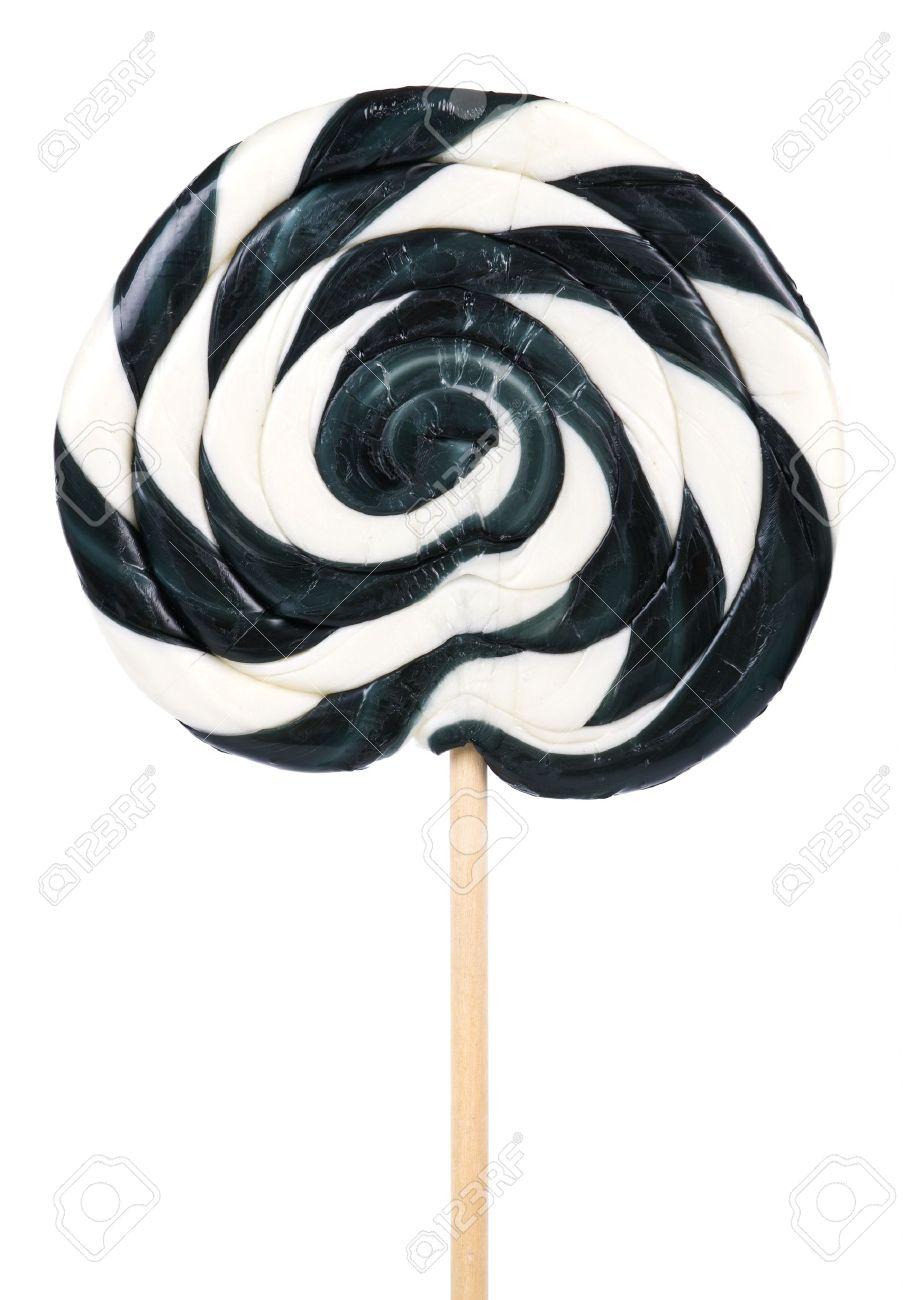 big black and white lollipop on stick over white stock photo