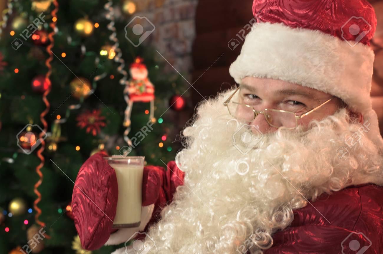 Santa Claus Drinks Milk With Cookies In Photo Studio 2018