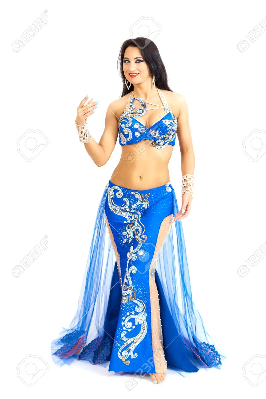 be51d727f A young dancer in blue clothes performs an oriental belly dance. Isolate.  Beautiful girl