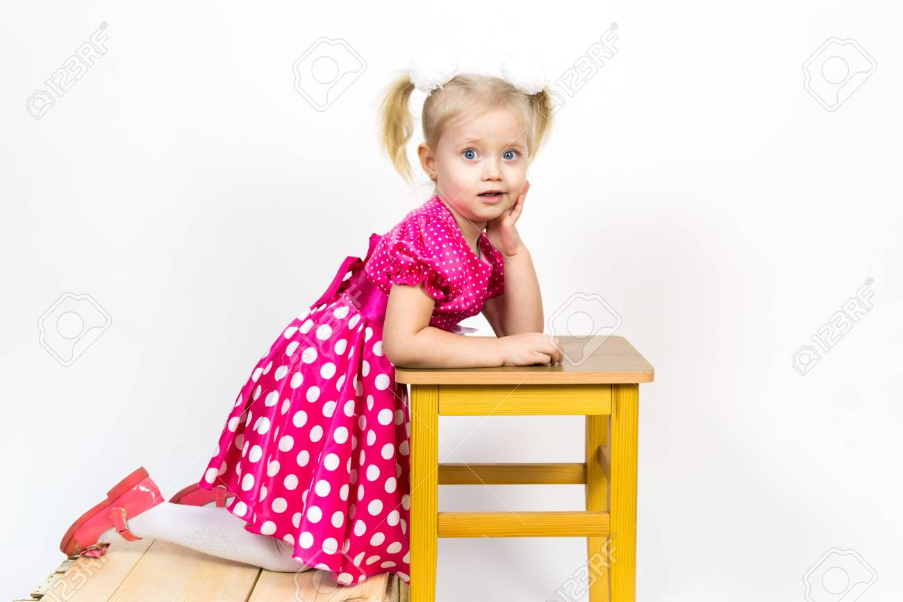 a9438e5eaf Little girl 3 years old in a red dress with bows in her hair. Beautiful