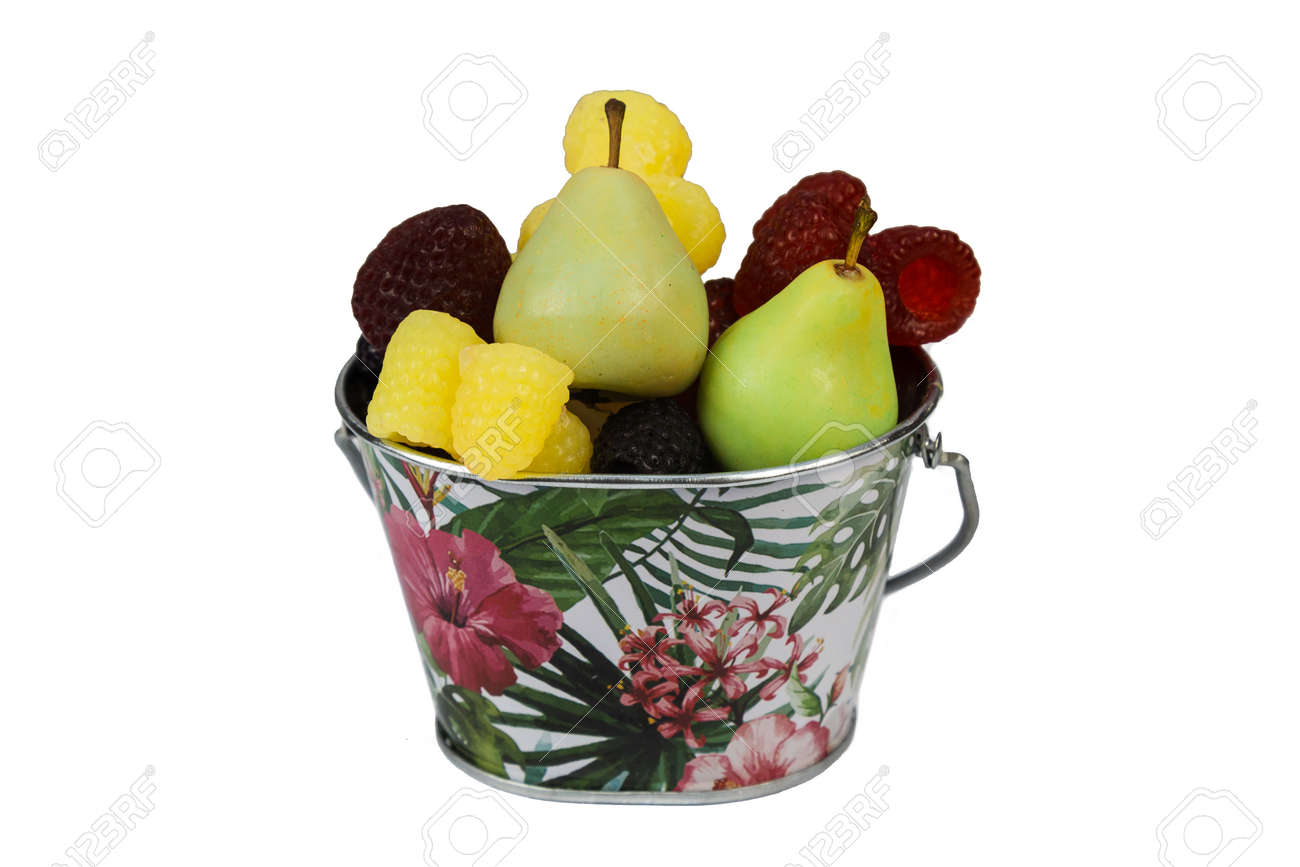 A full bucket of soap in the form of pears blackberries strawberries and raspberries on a white background. Isolated - 171955989