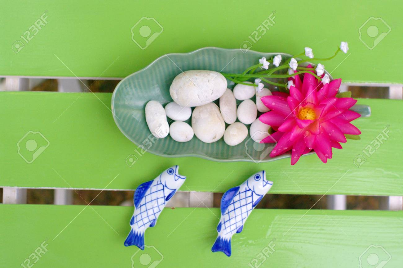 Lotus bloom in the plate on the table Stock Photo - 15095397