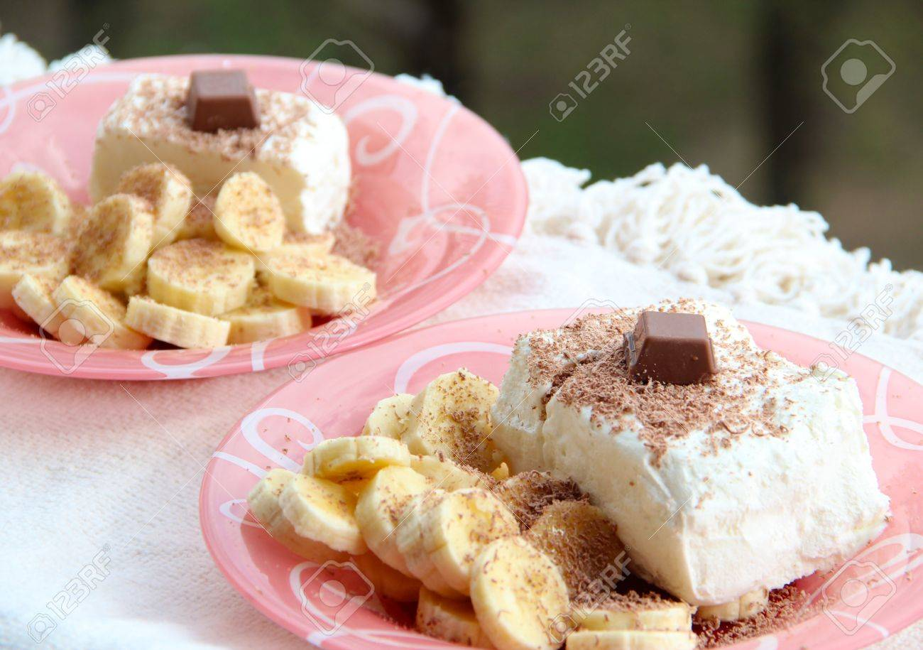 Ice cream with grated chocolate and slices of banana  two portions Stock Photo - 13933403