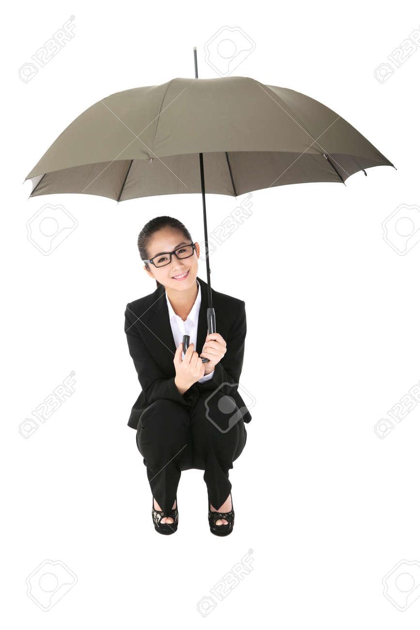Business woman holding an umbrella - 157166912