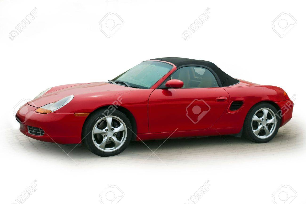 Stock Photo   White On A Small Red Sports Car