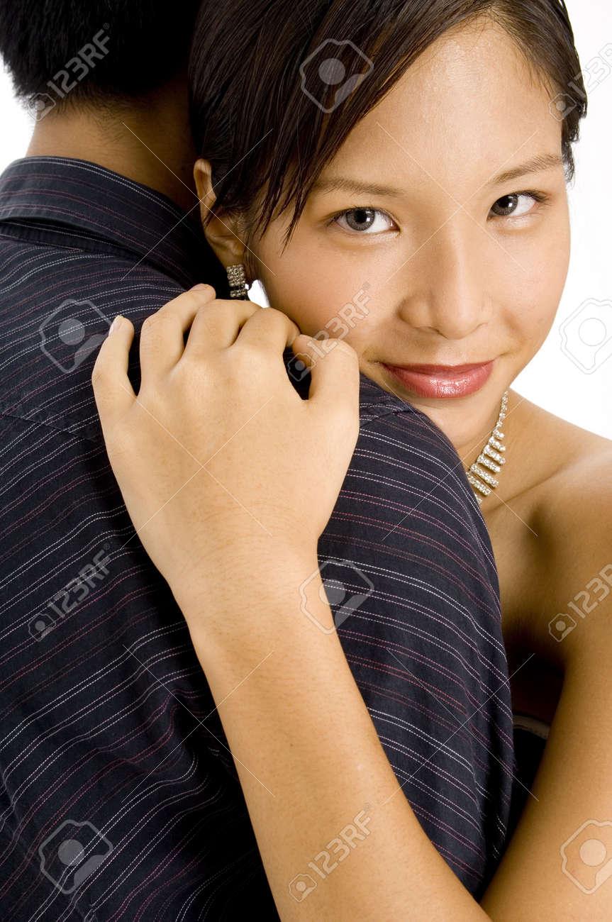 A young pretty asian woman hugs her man Stock Photo - 408647