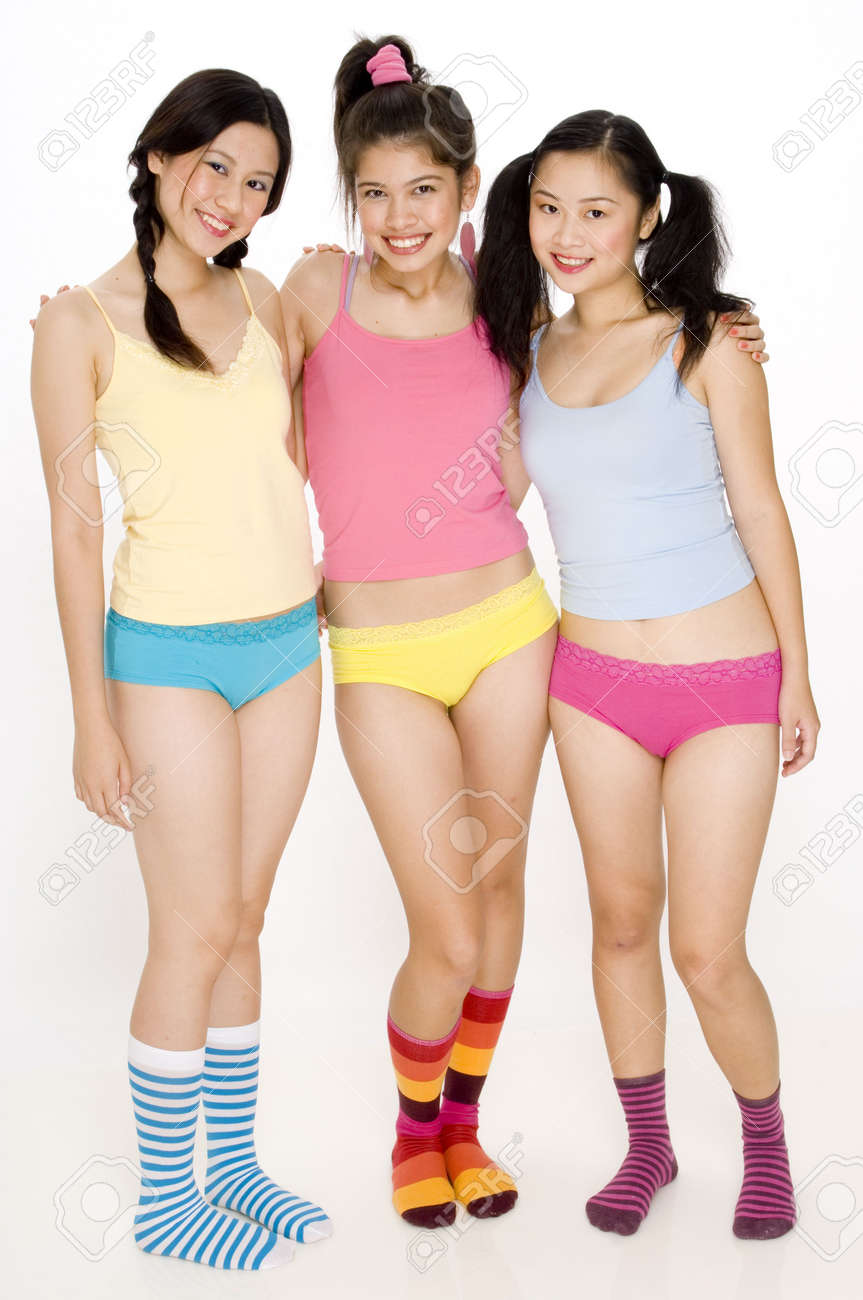 54d1c355556 Stock Photo - Three pretty young asian women in colorful underwear and socks