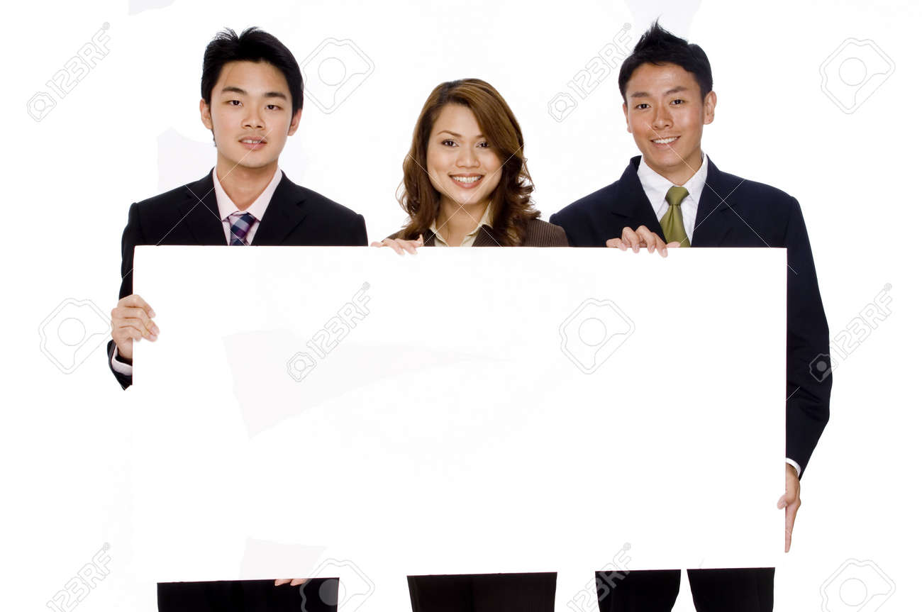 Three young asian business people hold up a large blank sign Stock Photo - 486362