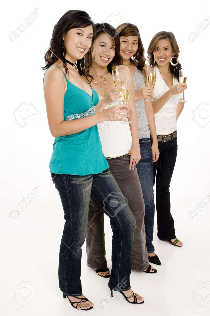 A group of four attractive young asian women drinking champagne Stock Photo - 502510