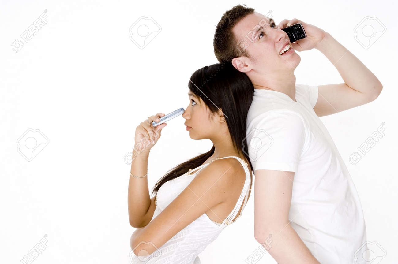 A young woman looks left out as her boyfriend talks on the phone Stock Photo - 502575