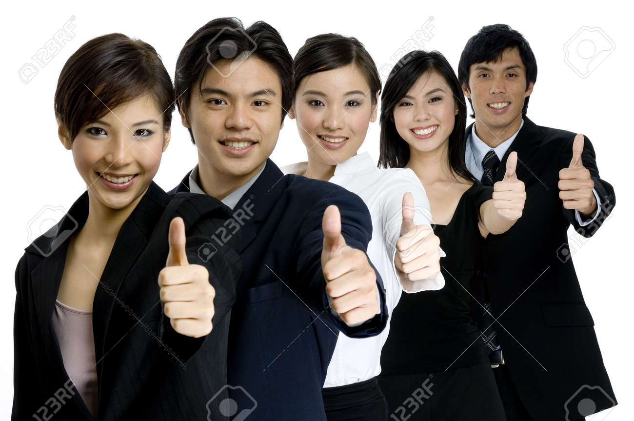 A young successful asian business team gives the thumbs up on white background Stock Photo - 582907