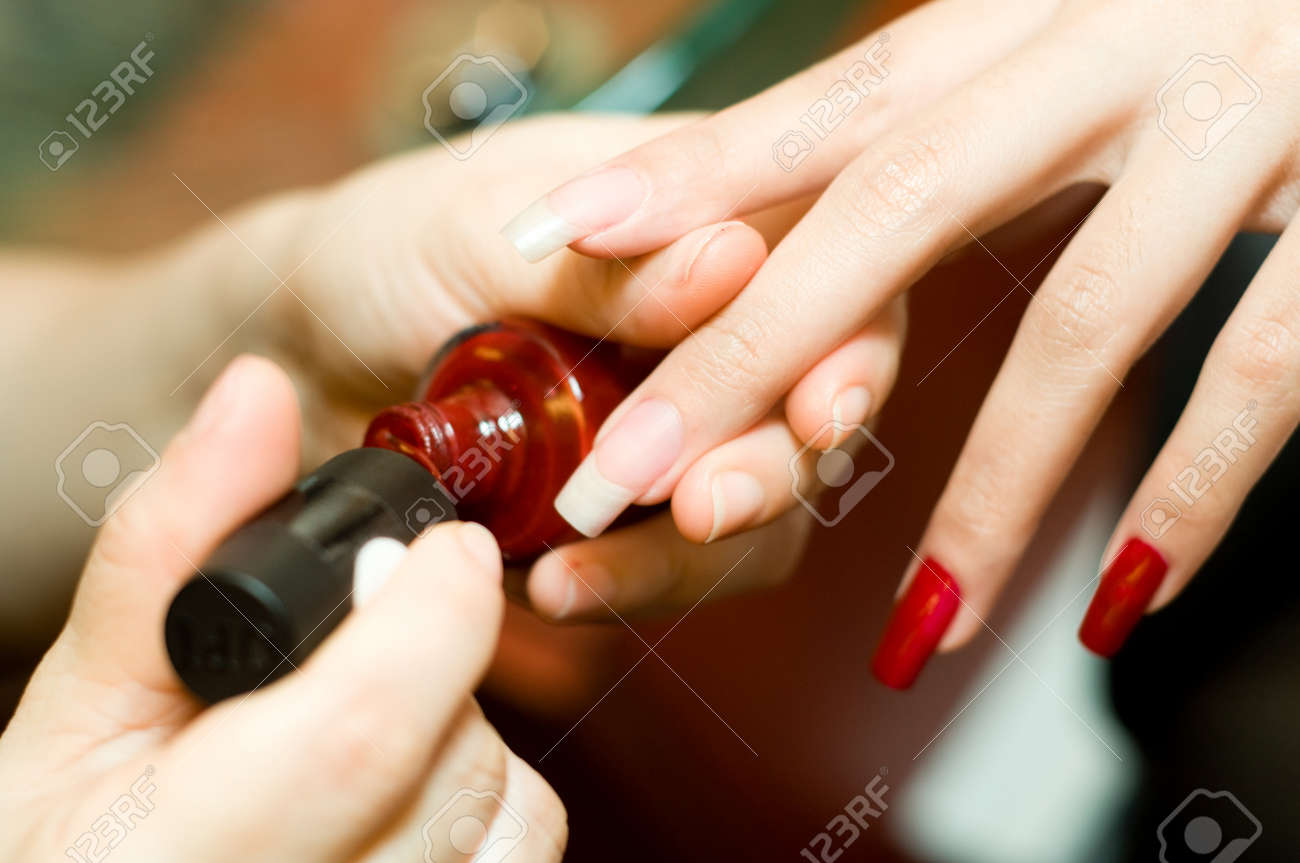 A young woman having manicure at a nail salon Stock Photo - 1481971