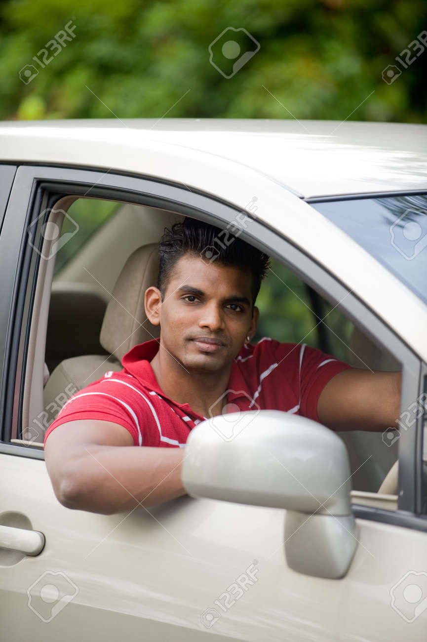 Saloon Cars in India Indian Man in a Saloon Car