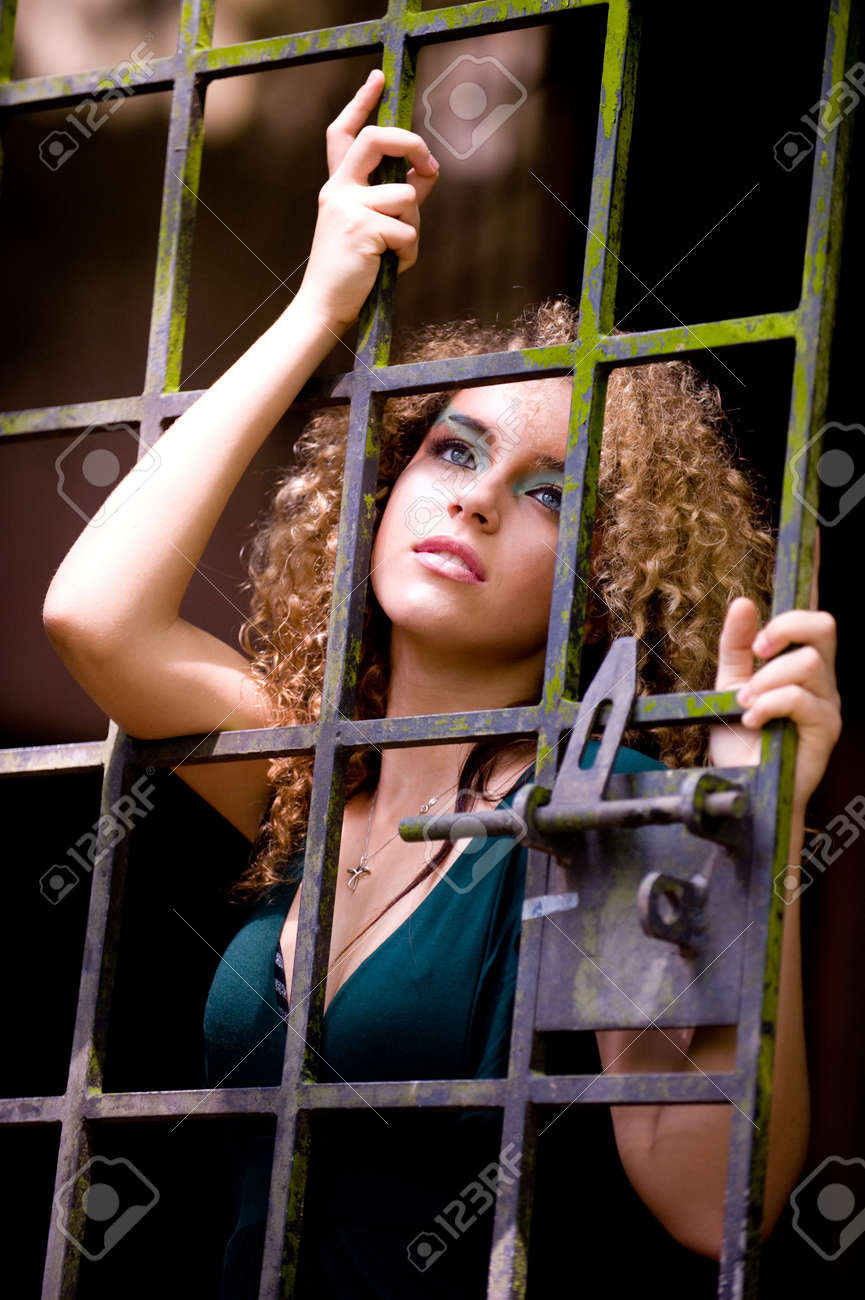 A pretty young woman behind bars Stock Photo - 2918709