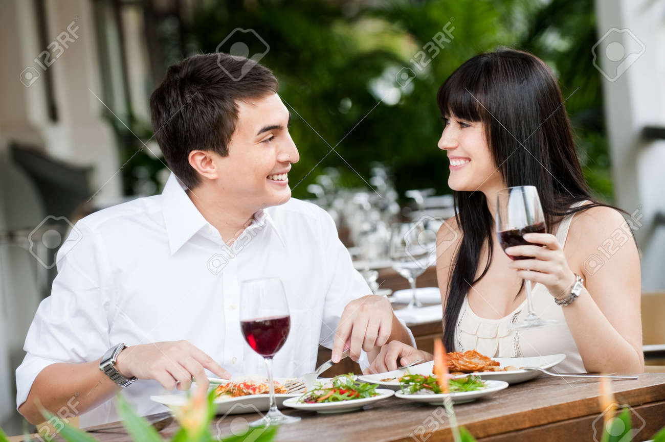 A young and attractive couple dining together in an outdoor restaurant Stock Photo - 5179603