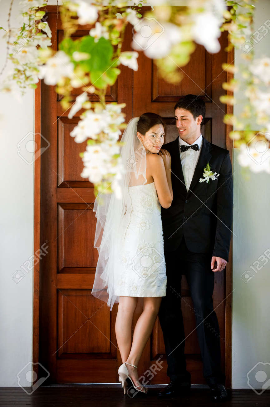 An attractive caucasian couple getting married outdoors - 6839359
