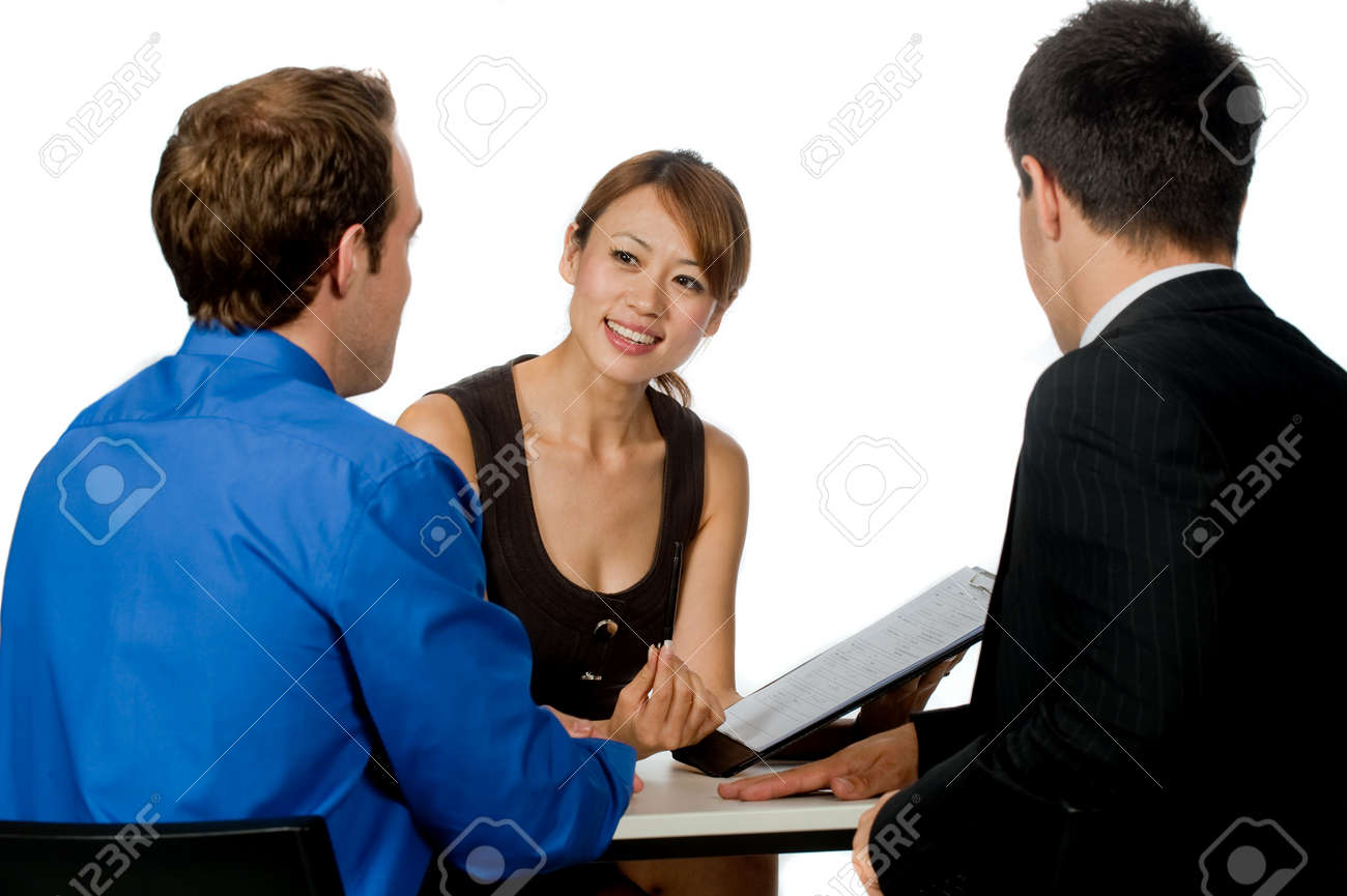A young and professional businesswoman having a discussion with two of her colleagues on white background Stock Photo - 7322784