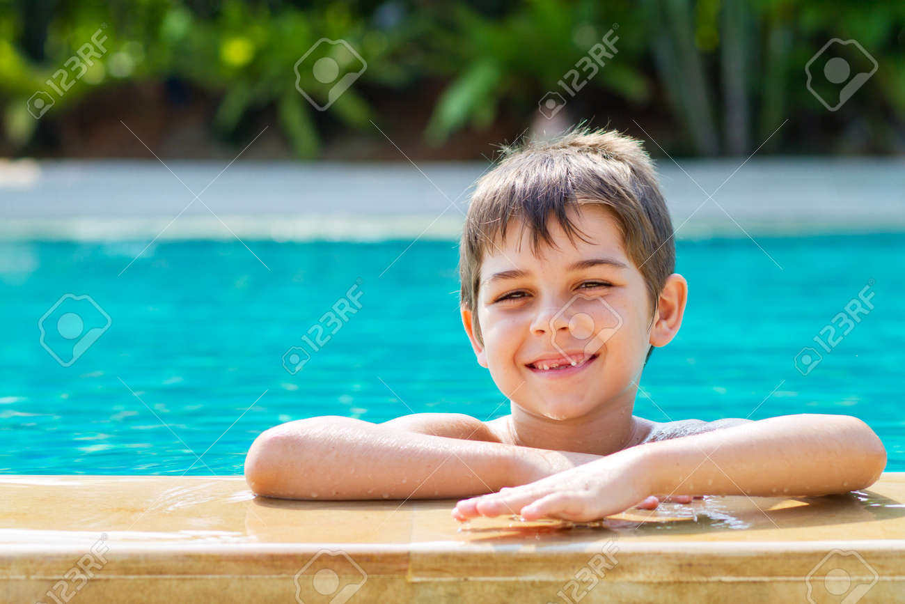 Happy young smiling boy in the pool Stock Photo - 9919174