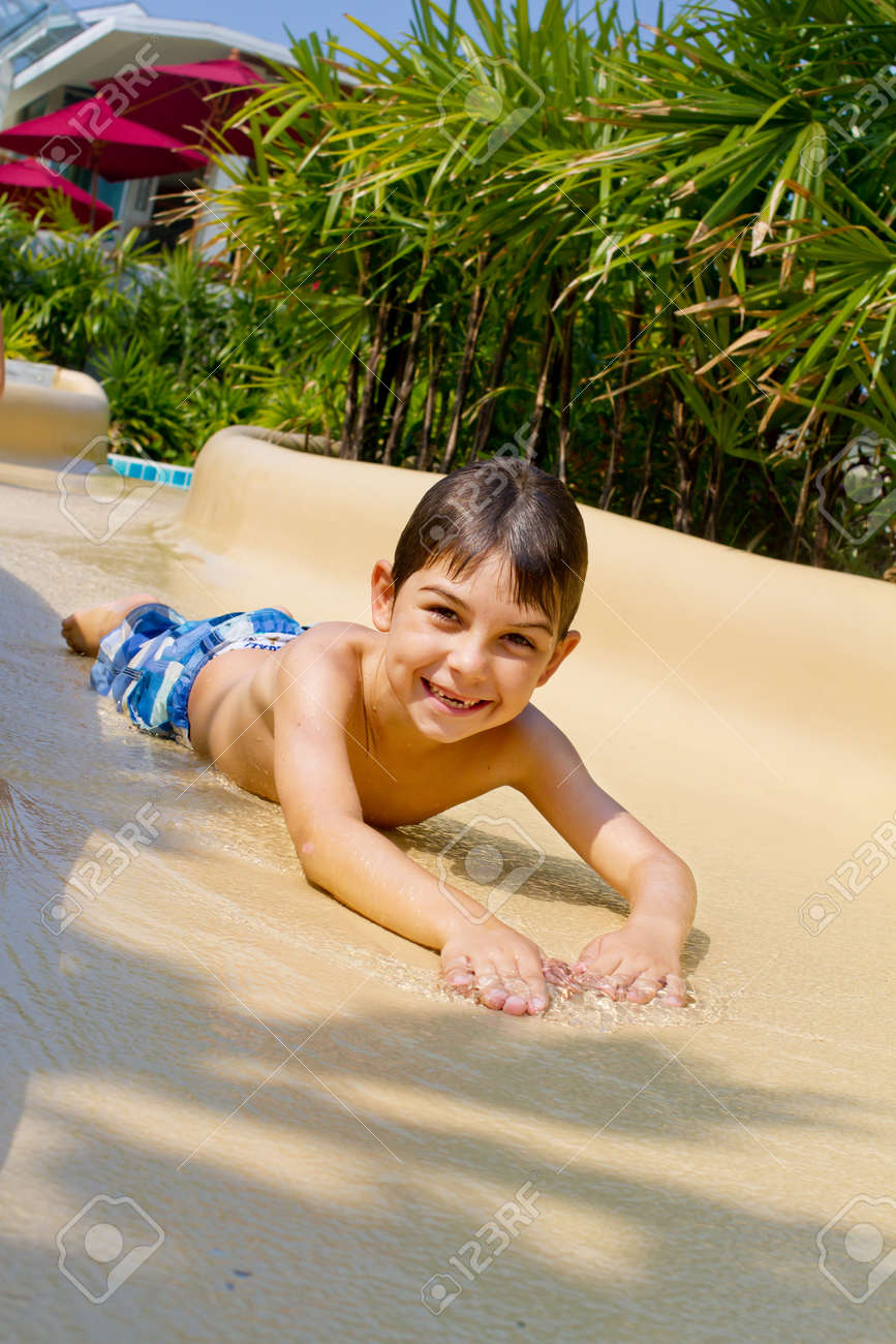 Young boy sliding down the water slide Stock Photo - 9919180
