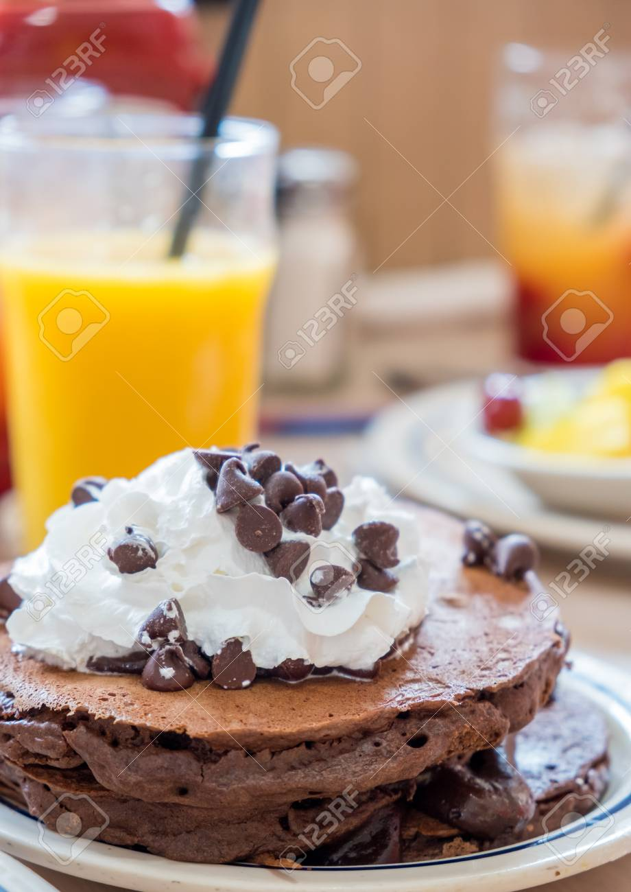 Plate Of Chocolate Pancakes With Whipped Cream And Chocloate Stock Photo Picture And Royalty Free Image Image 109243806