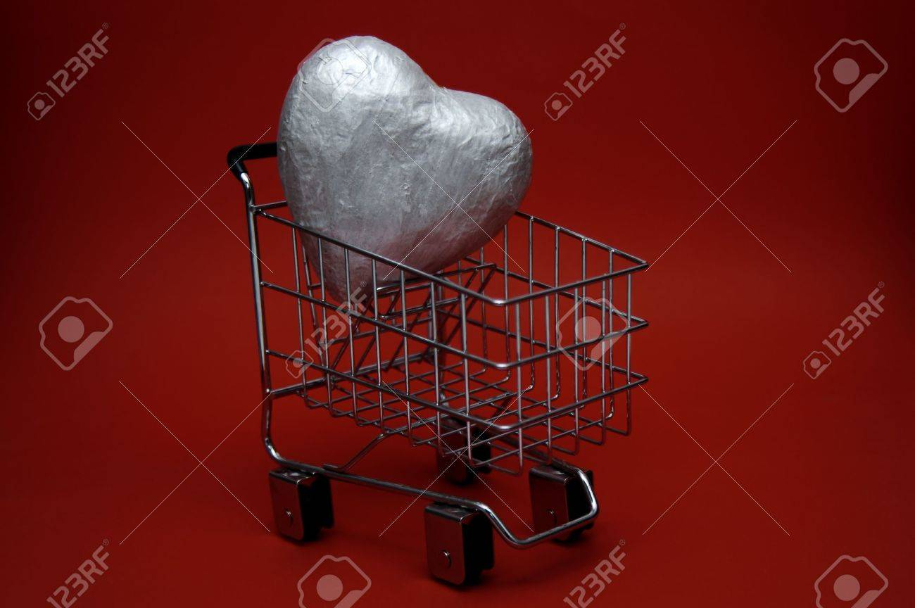 A Large Silver Heart Inside A Shopping Cart Could Represent A Love For  Shopping Or A