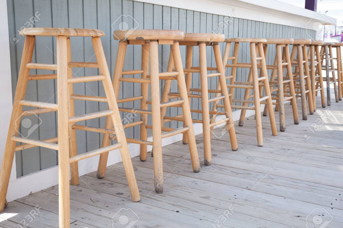 Simple wooden bar stools are lined up at an outdoor bar. Stock Photo - 28246220 & Simple Wooden Bar Stools Are Lined Up At An Outdoor Bar. Stock ... islam-shia.org