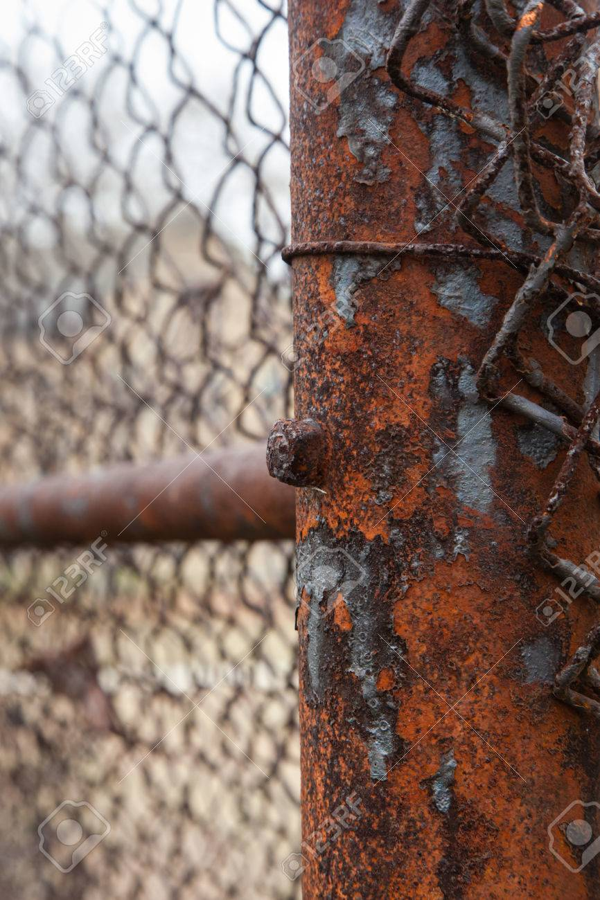 Rusty Iron On Old Chain Link Fence Post Vertical Image Stock Photo Picture And Royalty Free Image Image 51755312