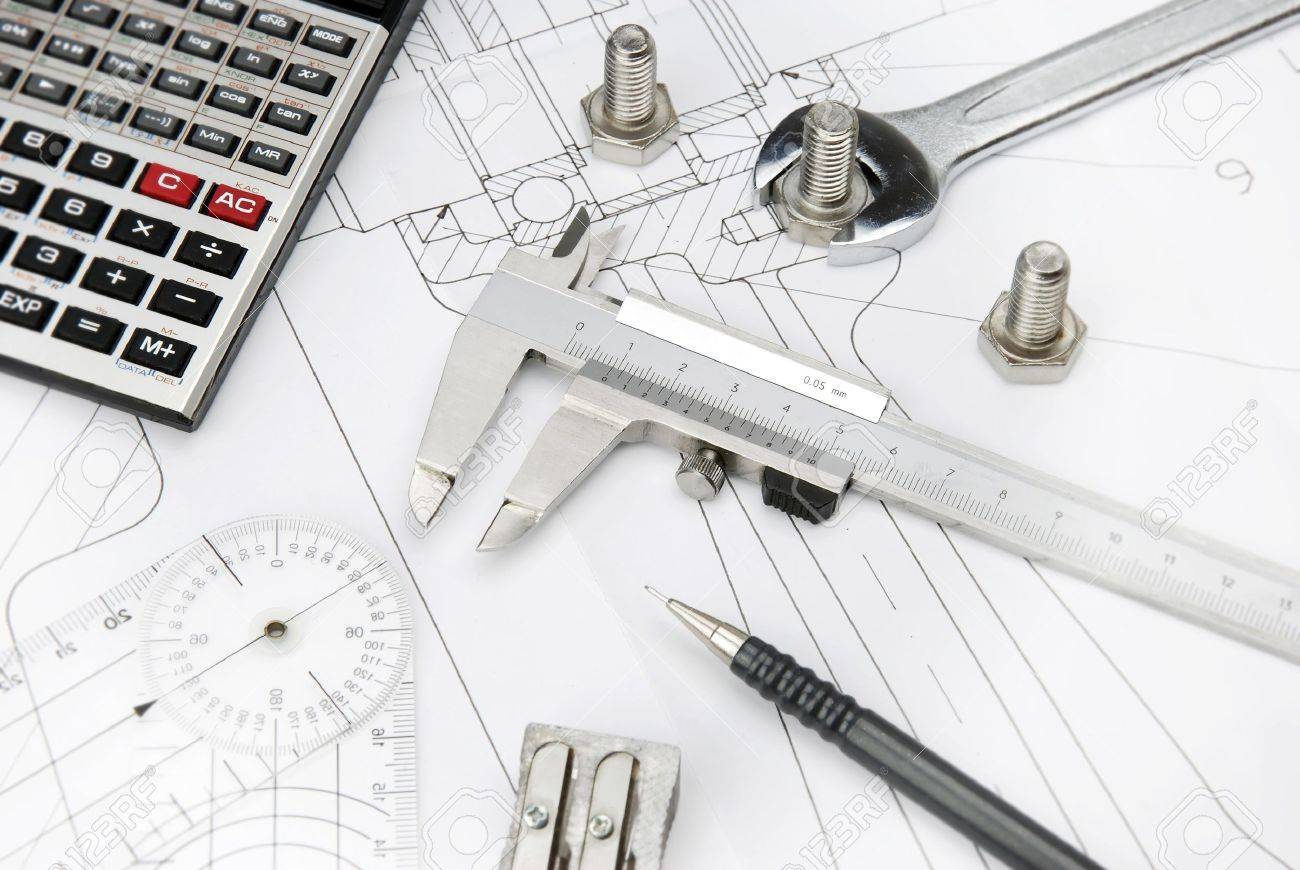 Calculator, Caliper And Bolts On A Technical Drawing Stock Photo ...