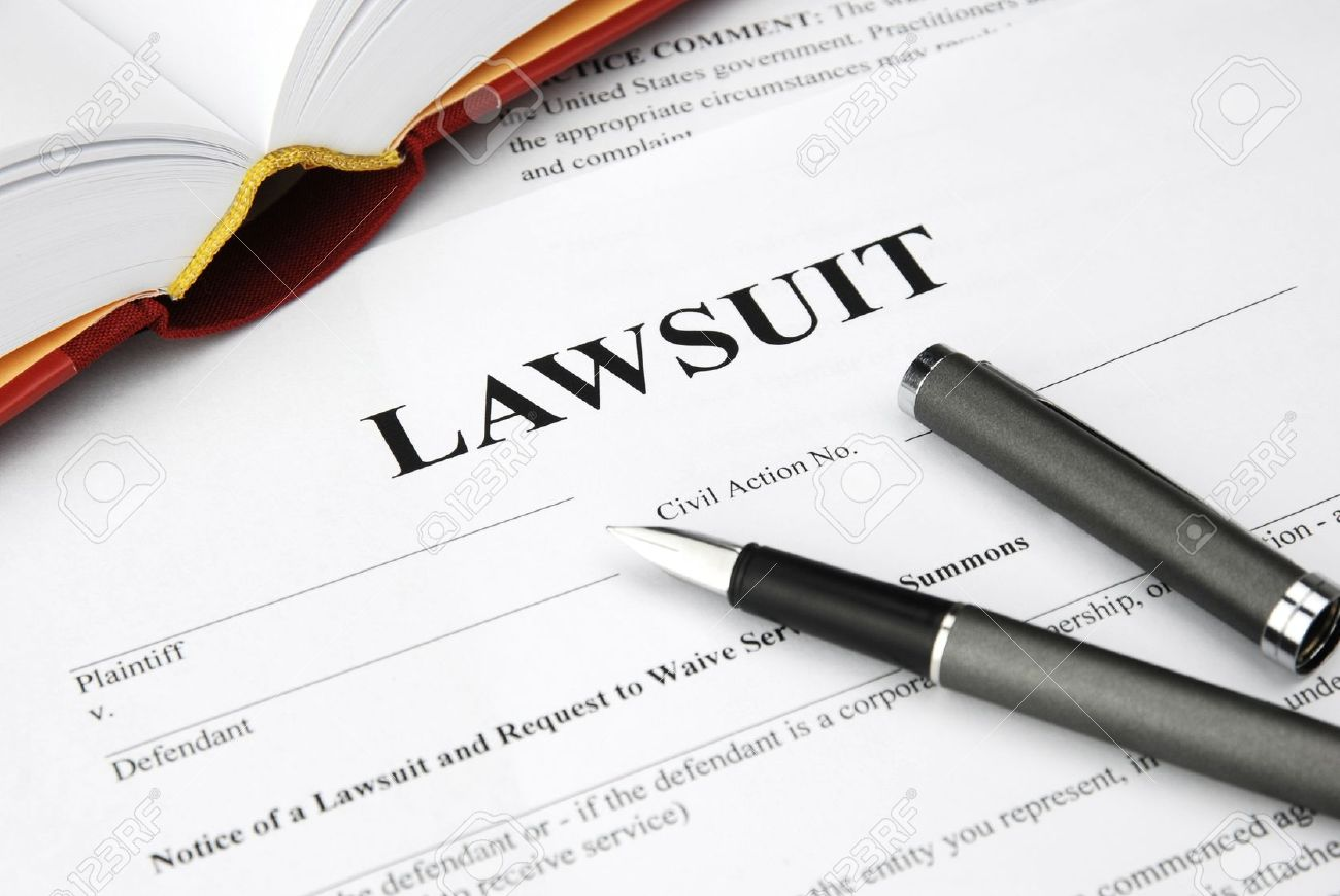 lawsuit form with filler and book Stock Photo - 12173490