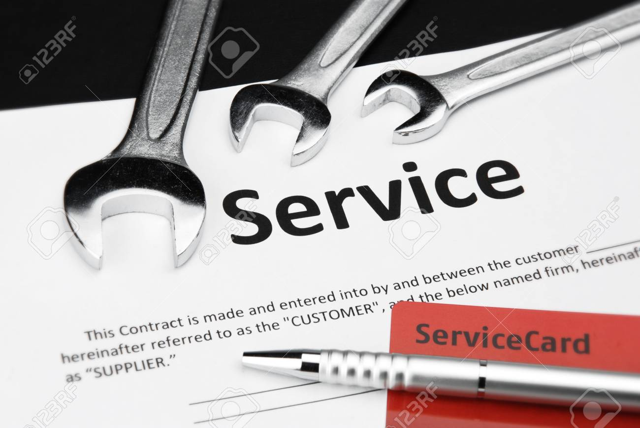 Service contract with card and wrench Stock Photo - 12173488