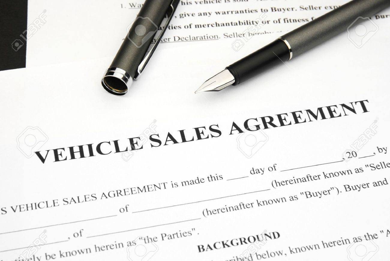 vehicle sales agreement document form with pen stock photo picture