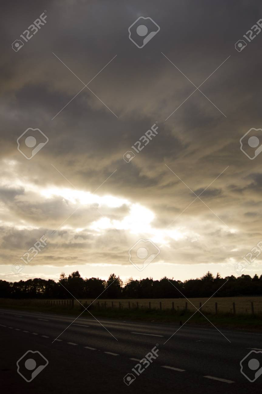 Sun bursting amongst dark clouds Stock Photo - 10662770