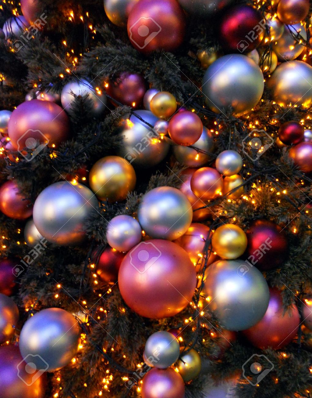 Modern Christmas baubles, many Christmas baubles of modern design, different sizes, red, silver and gold Stock Photo - 14812081